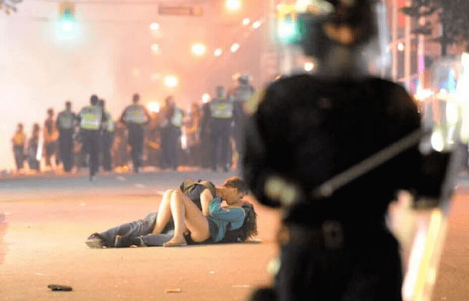 vancouver riot tender kiss political photos
